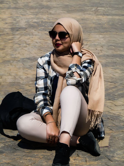 Sitting Adult Young Adult One Woman Only Only Women Sunglasses One Young Woman Only People Young Women Casual Clothing Portrait Day Beautiful Woman Lovely Girl Beauty Beautiful People Hijabbeauty Beautiful Girl Lifestyles Hijabstyle  Hijab Hijabfashion