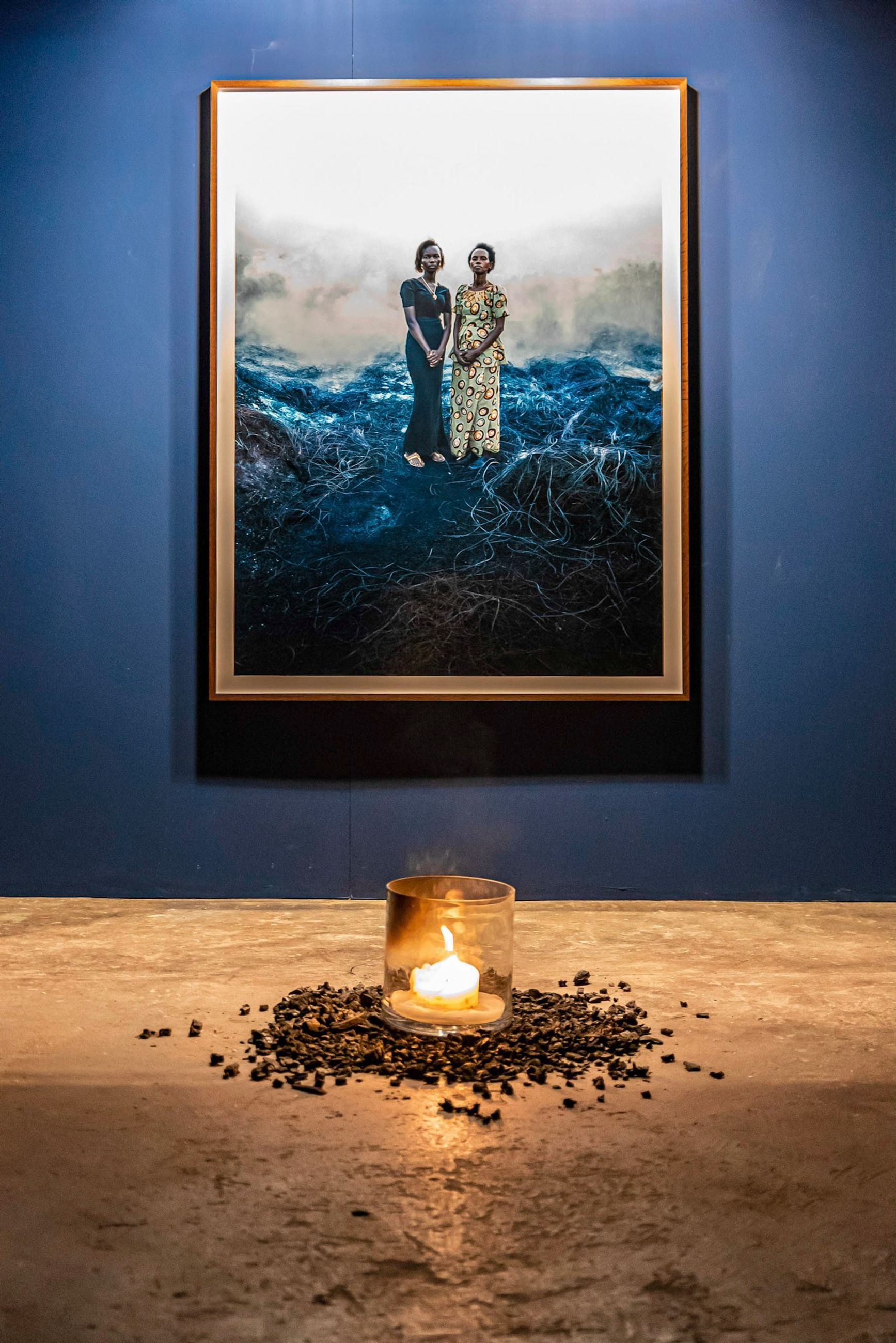 candle, nature, indoors, illuminated, human representation, flame, plant, female likeness, fire, glowing, burning, representation, table, lighting equipment, window, people, fire - natural phenomenon, transparent, tree, electric lamp