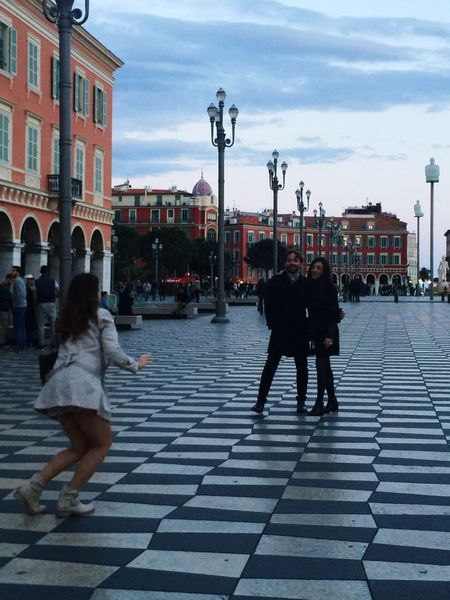 An Italian couple asking help from my friend from Napoli taking their picture. Awesome... So many Italian around Check This Out Taking Photos Nice France. Memories Lizaratravelphotography Travel Photography People Watching Nice Côte D'azur Place Massena