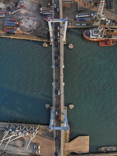 Top down view of harbor bridge Harbor River Drone Photograph DJI Mavic Air DJI X Eyeem Water High Angle View Nautical Vessel Transportation Architecture Aerial View Day Outdoors Mode Of Transportation Construction Industry Nature Industry No People Crane - Construction Machinery Construction Equipment Harbor City Sea Built Structure Travel 17.62°