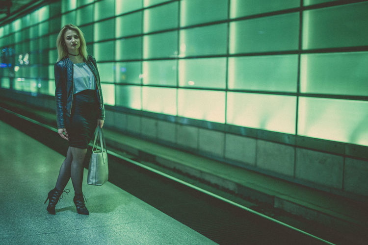 Full Length Of Woman Standing At Subway Station Platform