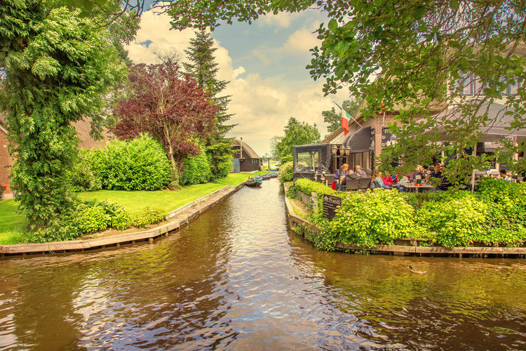 Beauty In Nature Bridge - Man Made Structure Canal Cloud - Sky Connection Giethoorn Green Color Nature Outdoors Plant River Sky Tourism Tree Village Water