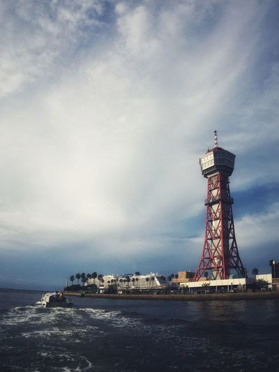 EyeEmNewHere Sky Built Structure Architecture Tower Sea Water Day Cloud - Sky Outdoors Building Exterior No People Lighthouse Nature Nautical Vessel Travel Destinations Scenics Beauty In Nature Horizon Over Water Shot On IPhone.