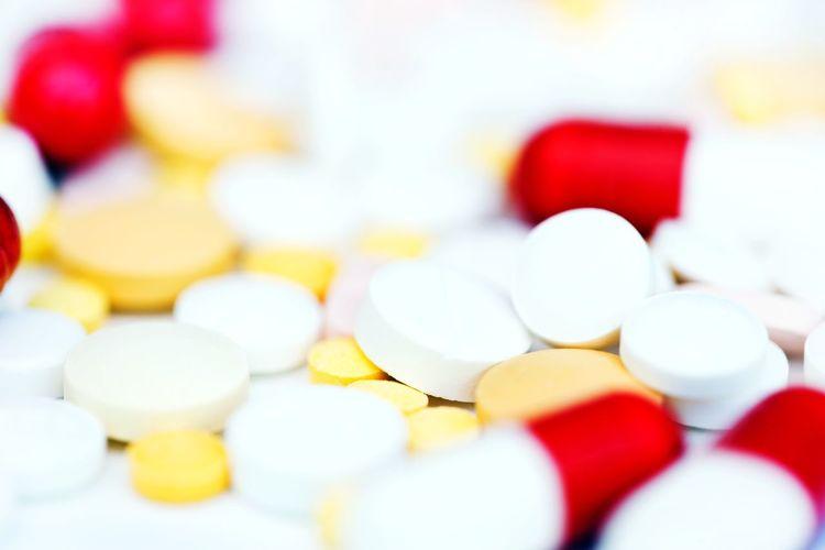 Multi colored medicine on white background