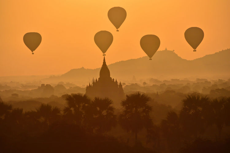 hot balloons at Bagan in the moorning Holiday Vacations Air Vehicle Architecture Balloon Beauty In Nature Belief Hot Air Balloon Mid-air Mountain Nature No People Outdoors Pagoda Temple Place Of Worship Religion Silhouette Sky Sunrise Sunset Transportation Travel Travel Destinations Tree Viewpoint