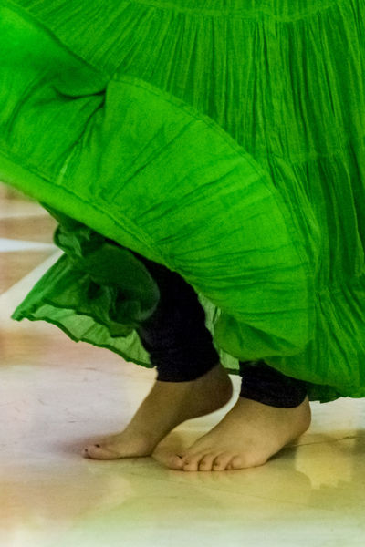 Close up of the bare feet of a female dancer wearing a green skirt. Activity Black Leggings Close-up Dancer Dancing Detail Feet Female Female Community Freshness Green Green Skirt Leggings Movement T