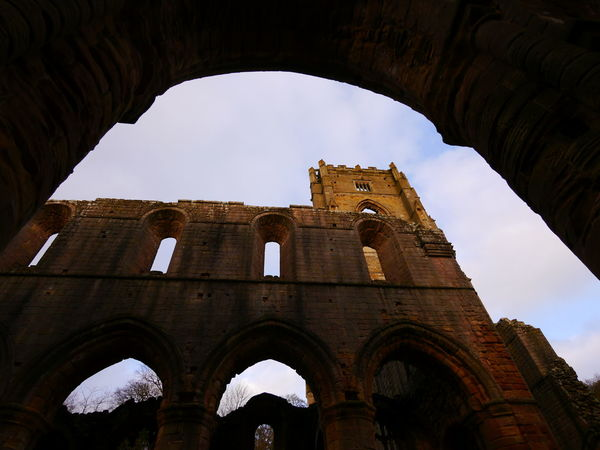 Arch Architecture Building Exterior Built Structure Day December December 2016 Fountains Abbey Fountains Abbey Yorkshire Fountains Abbey, Yorkshire History Low Angle View No People Outdoors Sky