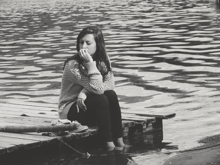 Young Woman Sitting In Water
