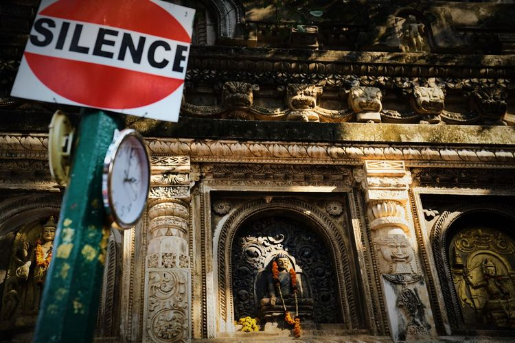 Meditation Place Arch Architecture Budhist Temple Building Building Exterior Built Structure City Communication Day History Low Angle View No People Road Sign Sign Text The Past Tourism Transportation Travel Travel Destinations Western Script