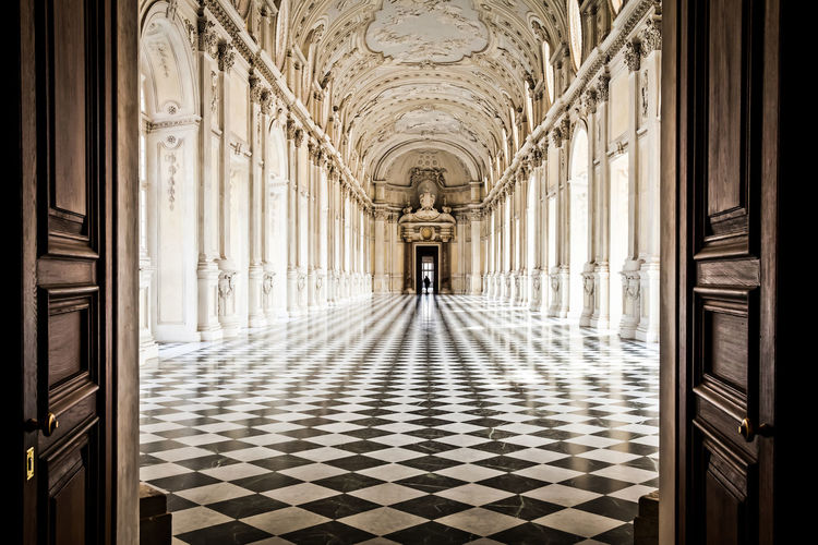 Arch Architectural Column Architecture Building Built Structure Ceiling Chandelier Colonnade Corridor Diminishing Perspective Door Empty Flooring In A Row Indoors  Interior Lighting Equipment Passage The Way Forward Tiled Floor