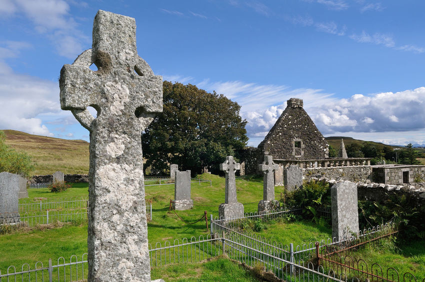 Celtic cross in the graveyardf at St Mary's, Dunvegan, Skye Architecture Celtic Cross Cemetery Church Churchyard Cloud Cloud - Sky Grass Highland History Monument No People Old Old Ruin Scotland Skye The Past Tombstone Tourism Tree