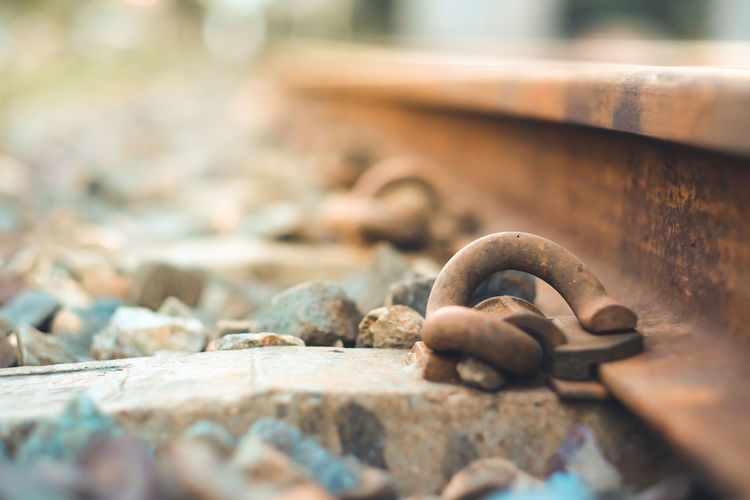 Close-up of rusty chain on rock