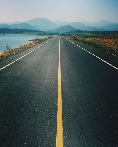 Road Road Marking Road Mountain The Way Forward Diminishing Perspective Transportation Mountain Range White Line Day Tranquility Straight Outdoors Sky Beauty In Nature Asphalt Nature Dividing Line No People Landscape Scenics First Eyeem Photo