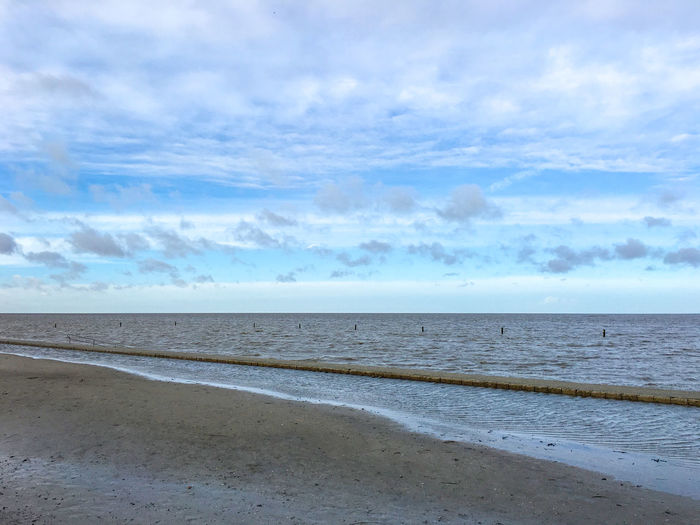 Nordseekueste, Norden-Norddeich, Germany Beach Blue Clouds Clouds And Sky Coastline Getting Away From It All Horizon Over Water Meer Norddeich / Norden Nordsee Ocean Outdoors Sand Sea Shore Sky Water Landscapes With WhiteWall