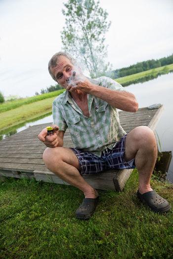 Man smoking cigar outdoors