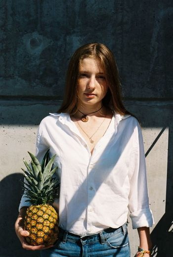 Film Film Photography 35mm 35mm Film Analogue Photography Front View Casual Clothing Real People One Person Lifestyles Young Adult Holding Young Women Hairstyle Outdoors Sunlight Women Day Leisure Activity Tropical Fruit Pineapple Redhair Whiteshirt  Light And Shadow Sunlight