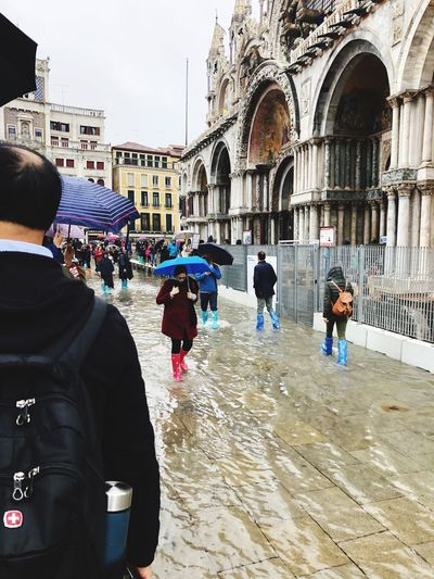 Flood in Venice. 2018. Acqua alta. People walked the streets of Venice knee-deep in water. Weather Venice Weather Italy Water_collection People Walked Deep Knee Venice, Italy Autumn 2018 Architecture Built Structure Real People Building Exterior Group Of People Crowd Women Large Group Of People City Walking Incidental People Outdoors Building Arch Day Leisure Activity