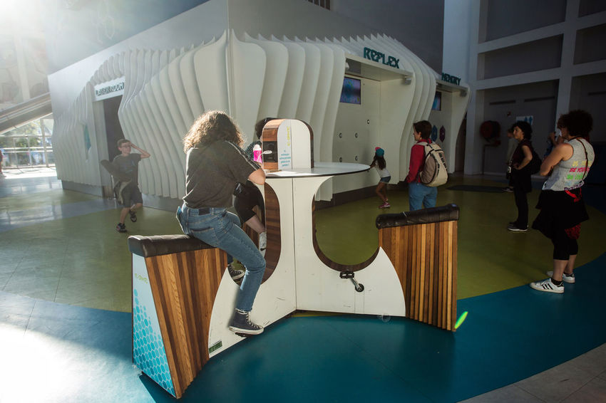 Futuroscope Futuroscope Theme Park Futuroscope Theme Park | Poitiers - France Futuroscope2017 Leisure Park Casual Clothing Charging The Phone Day Full Length Indoors  Leisure Activity Lifestyles People Real People Sitting Women Young Adult
