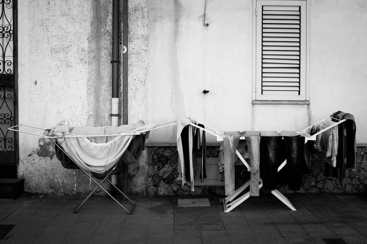 Chairs and table against wall of old building
