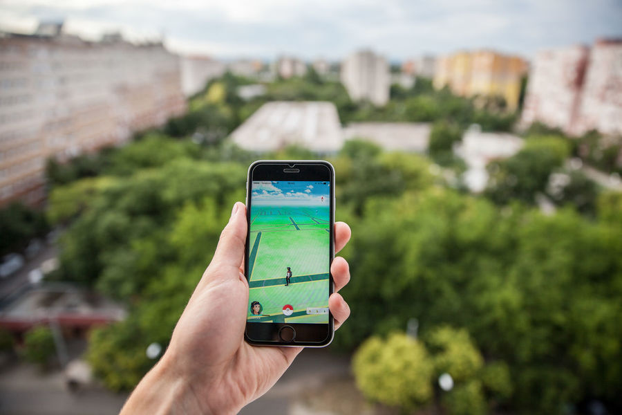 Apple iPhone6s held in one hand showing its screen with Pokemon Go application in the city. Adventure Augmented Autumn Day Daylight Editorial  Go I Illustrative Ios Night Nintendo Out Outdoors Paris Park Play Pokemon Go Pokémon Reality Relaxing Smartphone Summer Technology Virtual