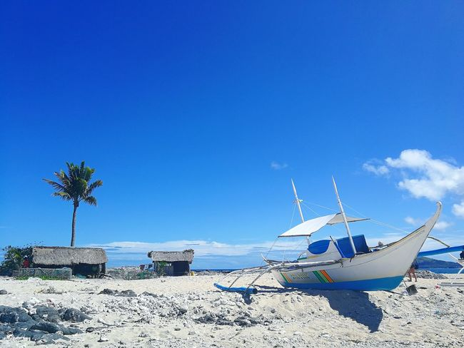 island hop Philippines Aporeef Mindoro Summer EyeEm Selects Huawei HuaweiP10 PhonePhotography Huaweip10photography Leicacamera Huaweiphotography Mobilephotography ASIA Iloilo IslasdeGigantes Gigantesisland #FREIHEITBERLIN Rocks Water Nautical Vessel Sailing Ship Sea Beach Blue Sand Sailboat Moored Shore Sandy Beach Calm