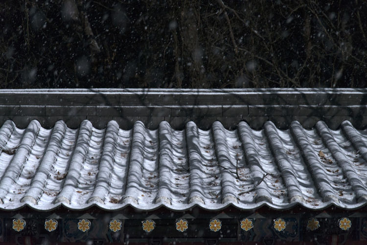 High angle view of roof tiles during snowfall