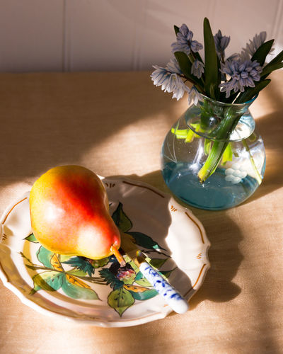 High angle view of cherry tomatoes in vase on table