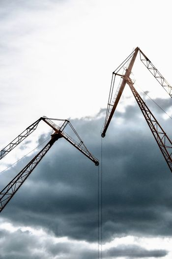 Conversation Sky Crane - Construction Machinery Low Angle View Construction Industry Nature Machinery Construction Site No People Industry Cloud - Sky Day Outdoors Construction Equipment Metal Tall - High
