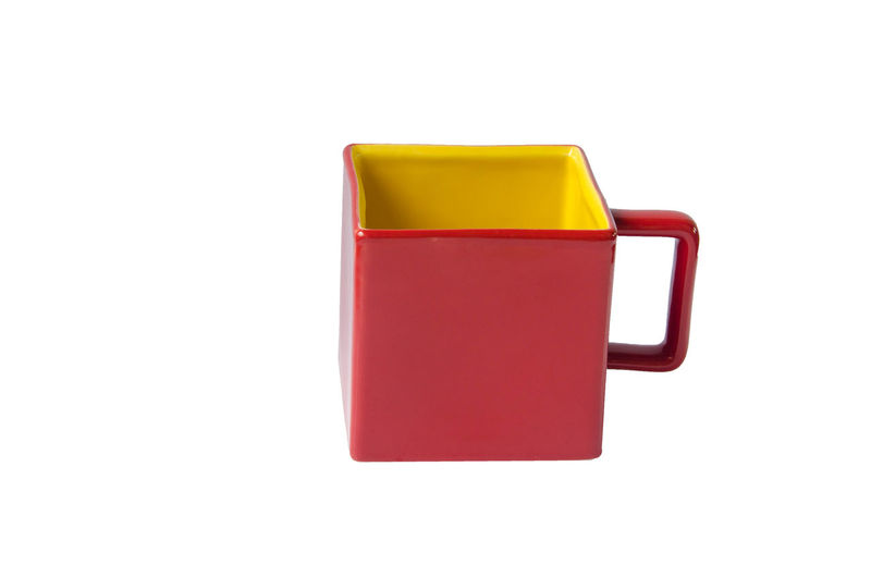 Mug square red and yellow cup on white background isolated Isolated Red Square Bottle Close-up Coffee Cup Container Copy Space Cup Cut Out Drink Food And Drink Isolated On White Isolated White Background Mug Red Refreshment Single Object Studio Shot Tea Cup White Background Yellow