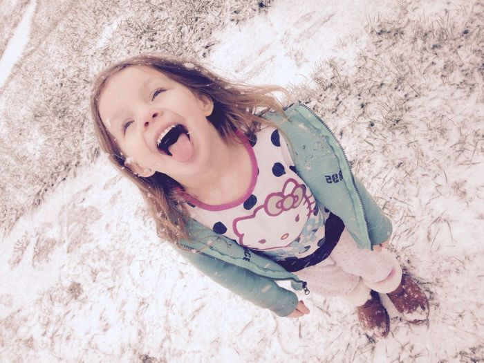 My Oldest Daughter Catching A Snow With Her Tongue Beautiful Gorgeous Girl Blue Eyes EyeEm Best Shots