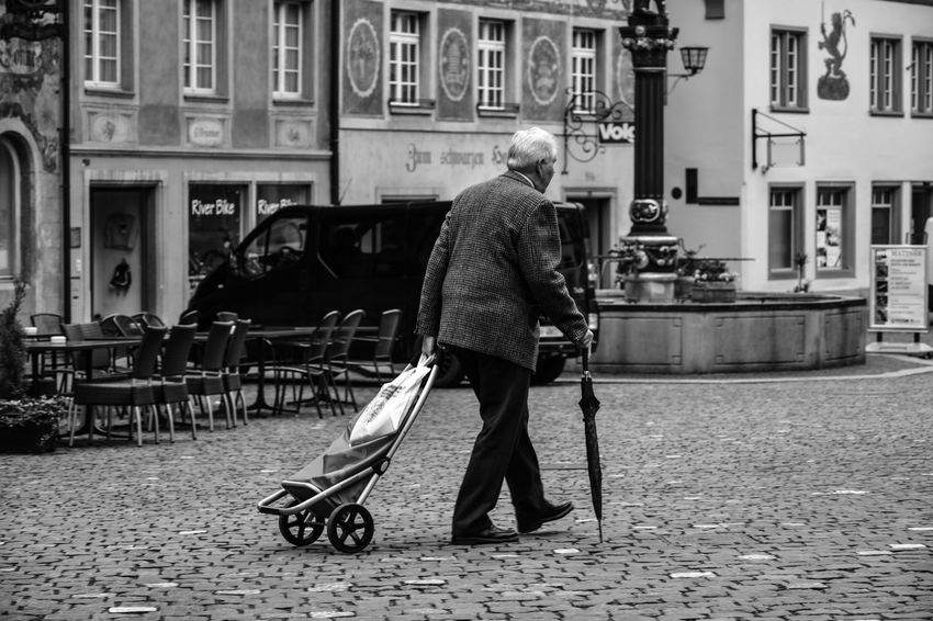 Day Full Length Lifestyles Men One Person Outdoors People Real People Trolley Walking
