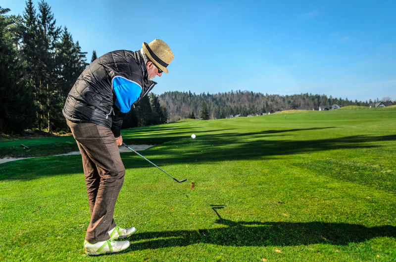 Man standing on golf course