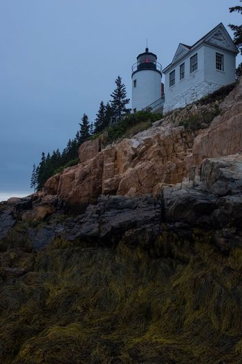 Low Tide Overcast Cloudy Fujifilm National Park Acadia Maine Red Light Bass Harbor Lighthouse Adventure Moody Tide Landscape Ocean Building Exterior Built Structure Architecture Building Sky Tower Guidance Lighthouse Nature No People Low Angle View Land Rock Plant Day Tree Safety