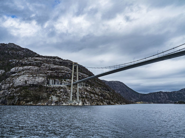 Low Angle View Of Bridge Over Mountain Against Sky