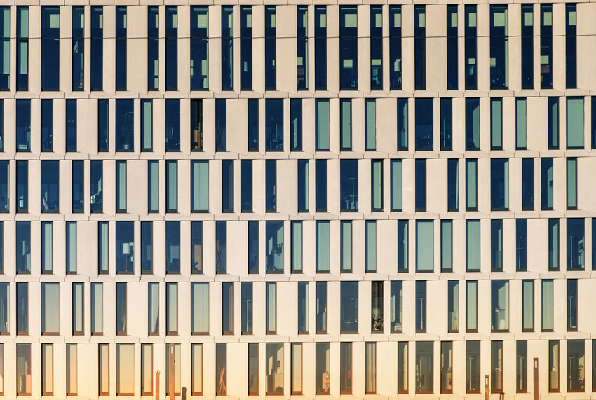 modern office building Architecture Backgrounds Building Business Business Finance And Industry Close-up Concept Day Exterior Façade Front View Full Frame Modern No People Office Building Outdoors Pattern Sunset Textured  Windows Work Workplace