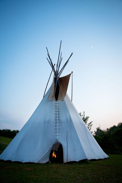 Campfire Moon Twilight American Native Architecture Blue Camping Clear Sky Copy Space Day Environment Field Grass Land Landscape Nature No People Open Door Outdoors Plant Red Indian Sky Teepee Tent Tipi The Architect - 2018 EyeEm Awards