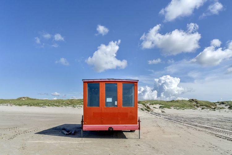 Amrum Amrum Kniepsand Beach Photography Construction Nature Telephone Box Beach Beachphotography Beauty In Nature Building Site Cloud - Sky Construction Trailer Construction Vehicle Construction Work Day Outdoors Red Roadworks Sand Site Trailer Sky Mix Yourself A Good Time The EyeEm Collection Premium Collection Getty Images