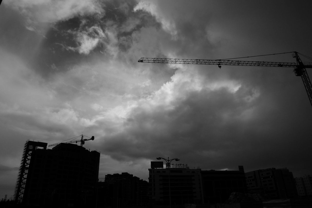 cloud - sky, sky, architecture, machinery, construction industry, building exterior, built structure, low angle view, crane - construction machinery, silhouette, industry, development, city, construction site, nature, crane, construction equipment, building, no people, outdoors