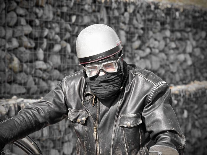 Man wearing mask and helmet outdoors