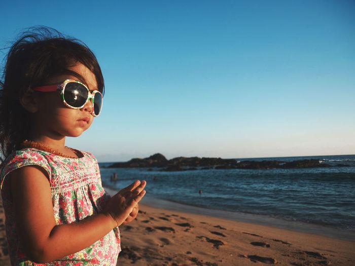 Portrait Of Girl Standing On Beach
