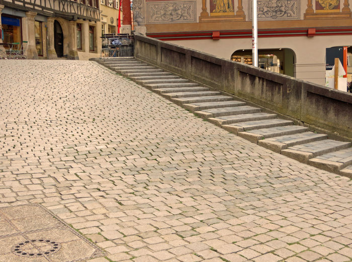 City Life Cobbled Streets Cobblestone Cobblestone Streets Cobblestones Day Leisure Time Medieval Medieval Town Shoping Sitting Outdoors Sitting Outside Stairs Town Urban Living