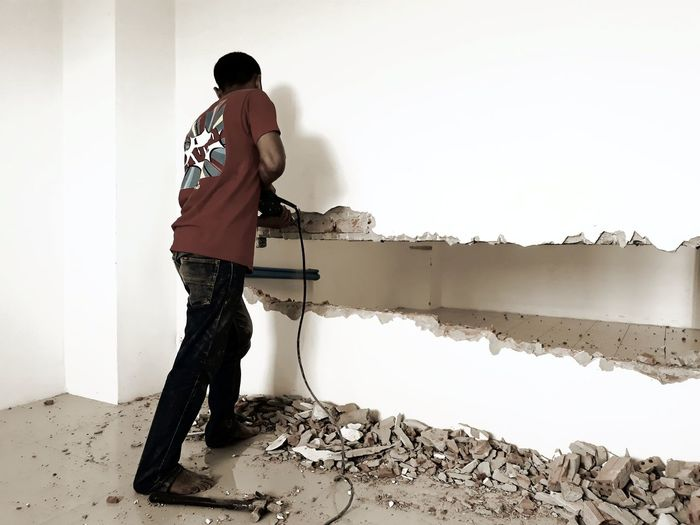 Side View Of Mature Man Working In House