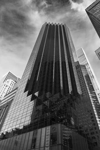 The Dark Tower. Trump tower in Manhattan in black and white. Putin Skyscrapers Architecture Black And White Building Exterior Built Structure Charlatan City Cityscape Conman Corporate Business Day Fraud Looking Up Low Angle View Modern No People Outdoors Sky Skyscraper Tall Tall - High Tower Travel Destinations Trump
