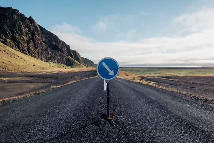 Ring Road in Iceland Road Sky Transportation Road Sign Mountain Sign Cloud - Sky Non-urban Scene Day Beauty In Nature Direction Communication No People Nature Scenics - Nature Environment Tranquil Scene Landscape Guidance Symbol Outdoors Iceland Ring Road