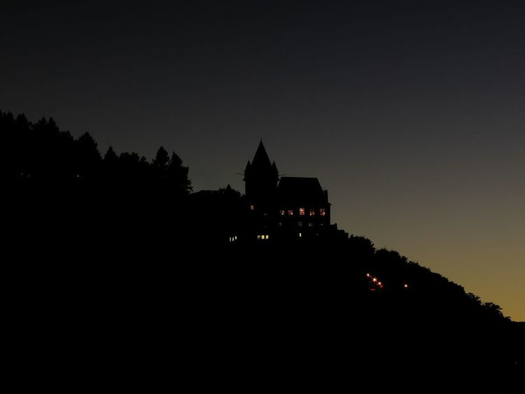 """Castle """"Stahleck"""" in Bacharach / Germany which is a youth hostel. Castle Steep Hill Weird Architecture Building Exterior Built Structure Darkness And Light History Illuminated Mountain Mysterious Nature Night No People Outdoors Silhouette Sky Sunset Tree Youth Hostel"""