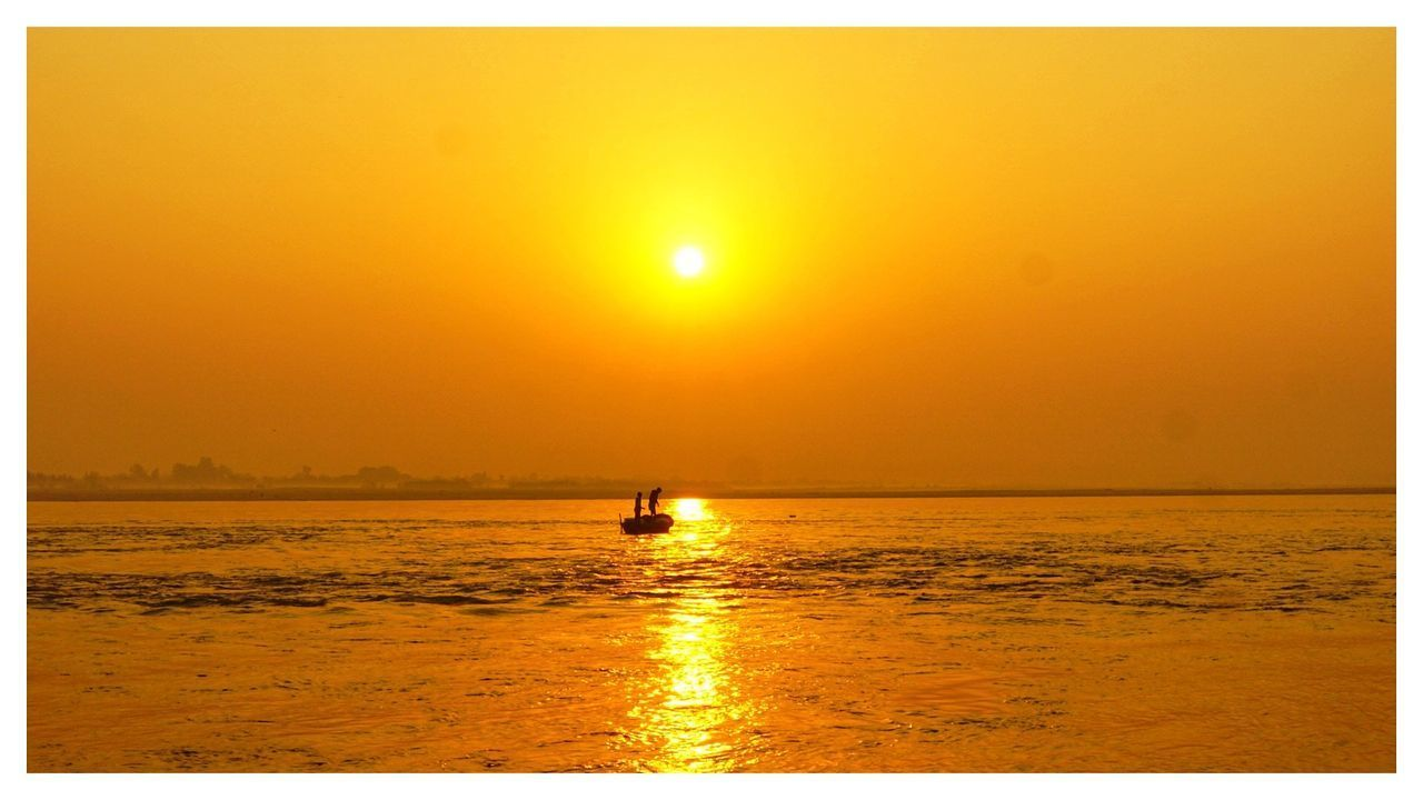 water, sky, sunset, auto post production filter, sea, scenics - nature, orange color, sun, transfer print, horizon over water, horizon, nautical vessel, beauty in nature, tranquil scene, tranquility, transportation, sunlight, nature, waterfront, outdoors, no people, bright
