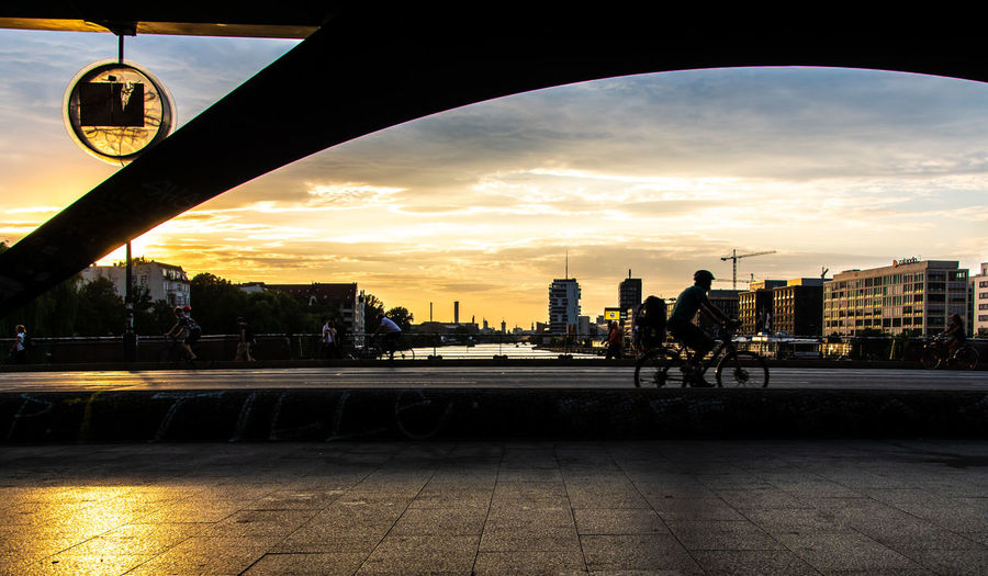 #urbanana: The Urban Playground Friedrichshain Oberbaumbrücke Architecture Bicycle Bridge - Man Made Structure Building Building Exterior Built Structure City City Life Cityscape Cloud - Sky Incidental People Nature Outdoors Real People River Silhouette Sky Street Sunset Tower Transportation Water Be Brave Summer In The City