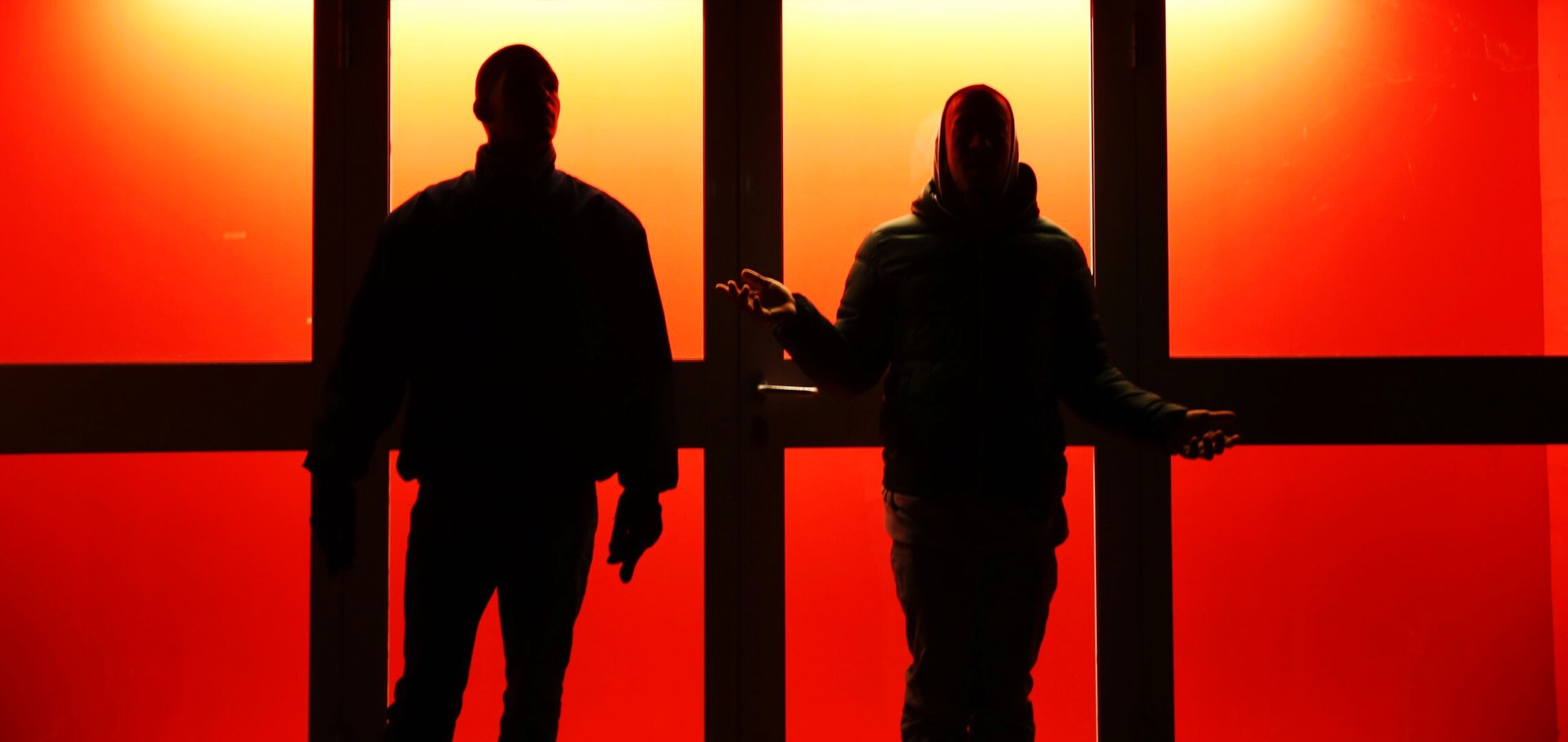 indoors, men, togetherness, lifestyles, silhouette, standing, red, love, bonding, person, rear view, leisure activity, three quarter length, sitting, orange color, communication, friendship