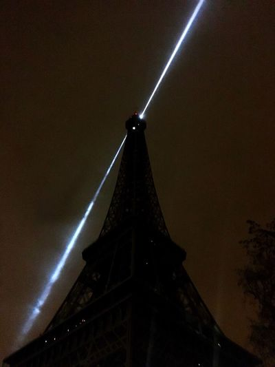 Artistic Installations Built Structure Architecture Low Angle View Shadow Night Illuminated Sky Foggy Night Phare City Paris Eiffel Tower Eiffel Tower By Night Bright Light Shinning Metallic Structure Streetphotography Monument Dark Darkness And Light Close Up Photography Silhouette Cloudy Sky Minimalist Architecture The City Light