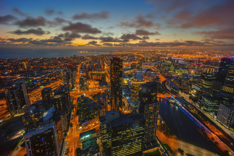 Aerial view of Dramatic Sunset dusk at Melbourne city, Australia Aerial View Architecture Building Exterior Business Finance And Industry City City Life City Street Cityscape Cloud - Sky Downtown District Dusk High Angle View Illuminated Modern Night No People Outdoors Panoramic Scenics Sky Skyscraper Street Sunset Travel Destinations Urban Skyline Adapted To The City